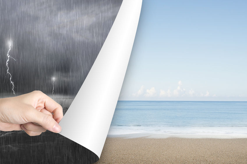 43555139 - woman hand open calm sea beach page to replace dark stormy ocean
